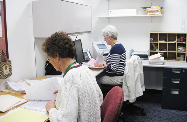 Volunteers Doing Office Work