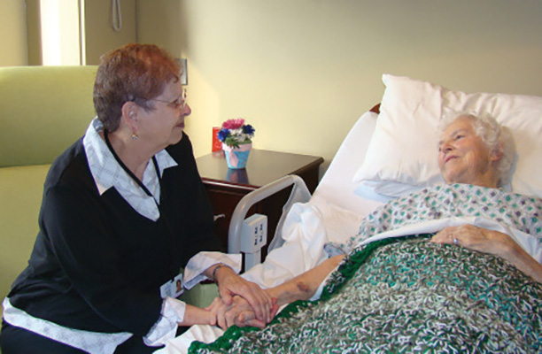 Volunteer Visiting A Patient